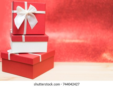 Christmas gift and Black Friday concept.Christmas and New Year's Gift.Stack of red gift box on red background.