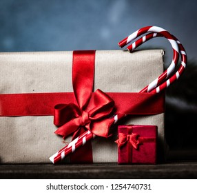 Christmas gift with bowknot and cup of tea on grey background