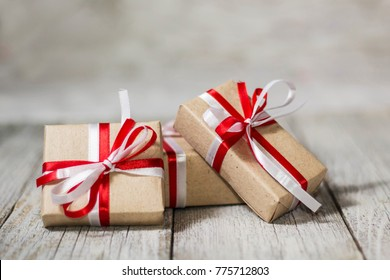 Christmas gift box against bokeh background. Holiday greeting card.