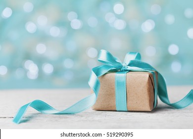 Christmas gift box against turquoise bokeh background. Holiday greeting card. - Shutterstock ID 519290395
