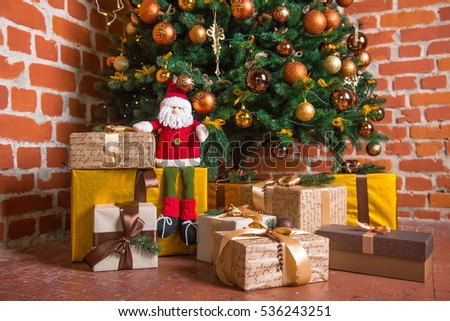 christmas gift box and baubles new year celebration decorated christmas tree with various gifts