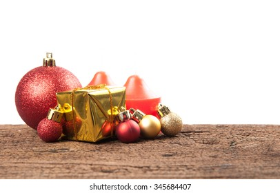 Christmas gift box with decorations and color ball on wood background