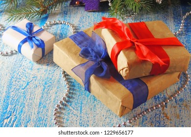 christmas gift box and decorations on a old wooden background