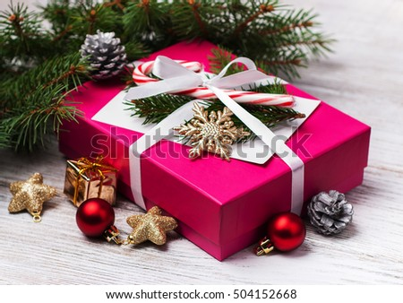 christmas gift box and decorations on a old wooden table