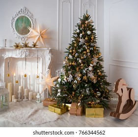 Christmas gift box in light coloured Interior room decorated in Christmas style. No people. An empty chair. Neutral colors. Home comfort of modern home.