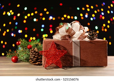 Christmas gift box on colourful lights background