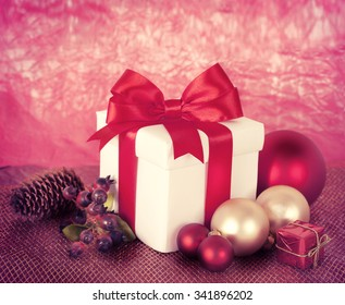 Christmas gift box on red background.