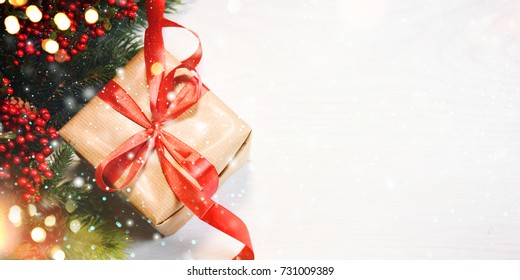 Christmas Gift Box On Wooden Background With Snowflakes, Greeting card Merry Christmas and Happy New Year