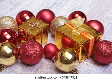 Christmas gift box with red and gold balls