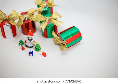 Christmas Gift Box and Santa doll  On white Background. Merry Christmas and Happy New Year concept.