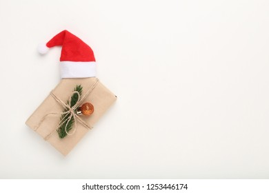 Christmas gift box with santa hat on white background