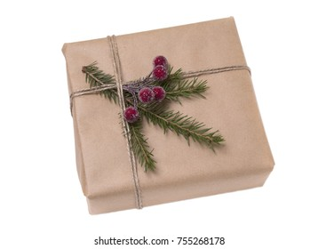 Christmas gift box wrapped in kraft paper. Isolated on white background