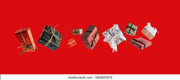 Christmas gift boxes falling or flying in motion on red background. Christmas shopping concept. - Shutterstock ID 1843693576