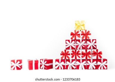Christmas gift boxes in the shape of a Christmas tree pyramid Isolated on white