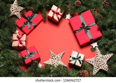 Christmas Gift Boxes and Stars on a Red Background