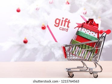 Christmas gift card and gift boxes in a shopping cart