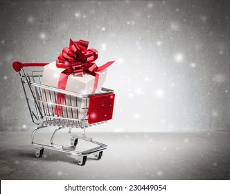 christmas gift in cart - wall and snow