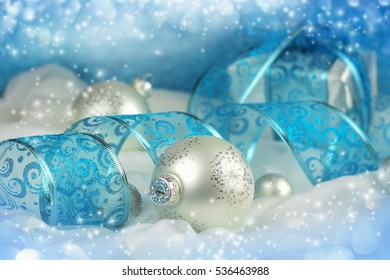 Christmas gift and decoration on blue background.