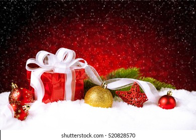 Christmas gift with decoration on snow. Studio shot