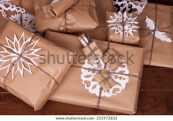Christmas gift and decorations for tree on wooden background