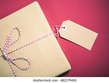 Christmas gift with empty name label, copy space for text