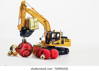 Christmas gift with  Excavator model ,  Holiday celebration concept new year on white background