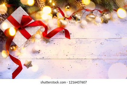 Christmas gift;  holidays composition on wooden background; Christmas tree decoration and copy space for your text