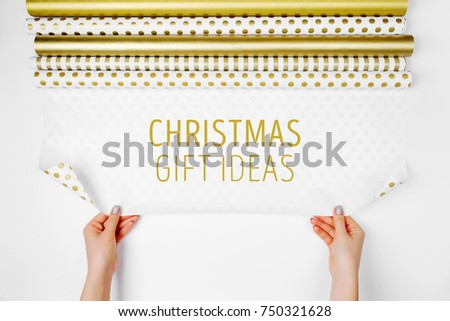 Christmas Gift Ideas Woman Packing In Gold Paper With Blank Space On A White