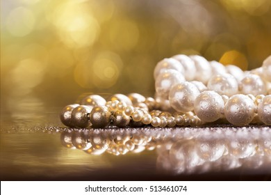 Christmas gift jewelry - beautiful pearls necklace closeup with copy space