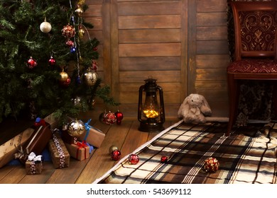 christmas gift and objects under fir tree interior home