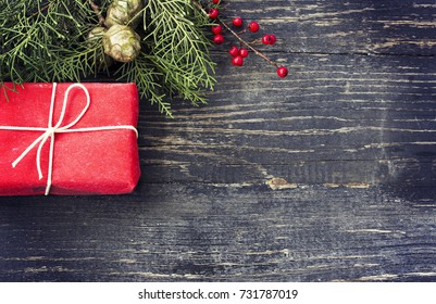 Christmas gift on a dark wooden background.Toning effect