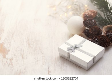 Christmas gift on white wooden background