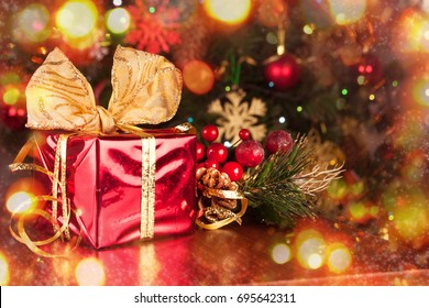 Christmas gift on the wooden background