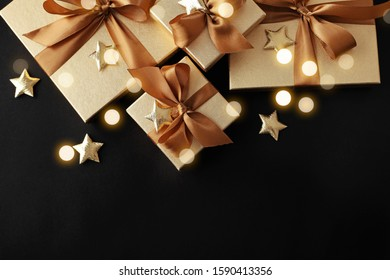 christmas gift and ornaments on black background