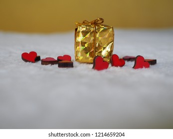 Christmas gift with red hearts on white background, place for text
