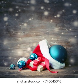 Christmas Gift with santa hat and christmas decoration on wooden background - Shutterstock ID 745045348