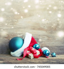 Christmas Gift with santa hat and christmas decoration on wooden background - Shutterstock ID 745049005
