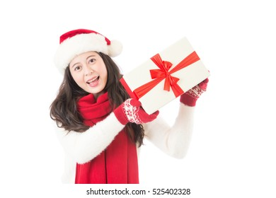 Christmas gift woman isolated. Happy excited santa woman showing christmas present isolated on white background.