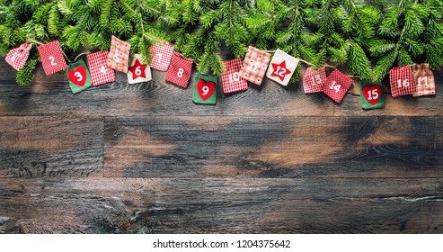 Christmas gifts Advent calendar on wooden background