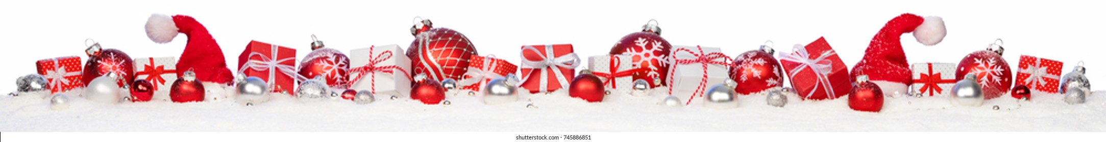 Christmas Gifts And Baubles On Snow