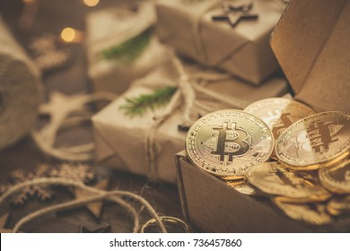 Christmas. Gifts. Bitcoins in a vintage style gift box on a rustic wooden table