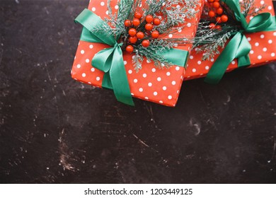 Christmas gifts boxes. Brown background, top view