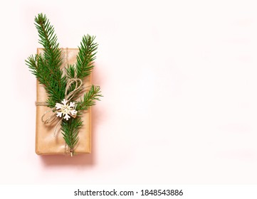 Christmas gifts are decorated with natural materials and wooden star trinkets. Zero Waste Christmas