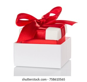 Christmas gifts, decorated with red bow in white box isolated on white background