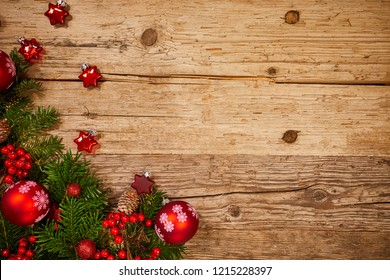 christmas gifts decoration on antique rustic wooden background; above view looking down with wood , top view with wood copy space