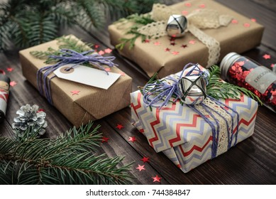 Christmas gifts with christmas decoration on wooden background closeup