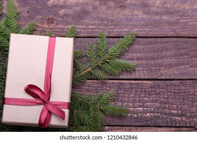 Christmas gifts. Christmas decoration with presents and red ball with fir branches