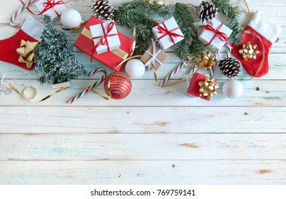 Christmas gifts and decorations over a wooden background