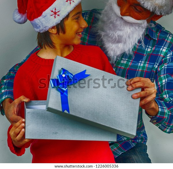 Christmas Gifts Father Son Exchanging Glances Stock Photo