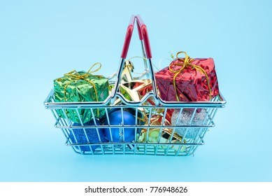 Christmas gifts and fir tree in the shopping cart